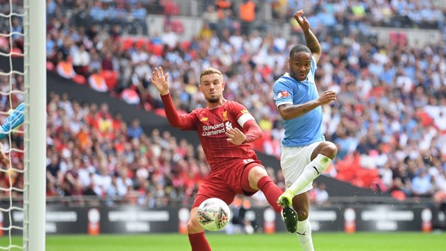 NO MISTAKE : Raheem Sterling fires City into the lead on 12 minutes.