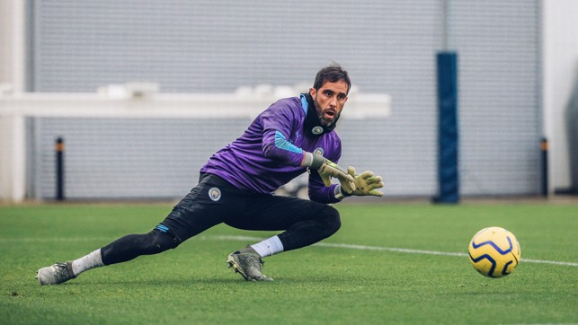 SAFE HANDS : Claudio Bravo gets down to smother the ball