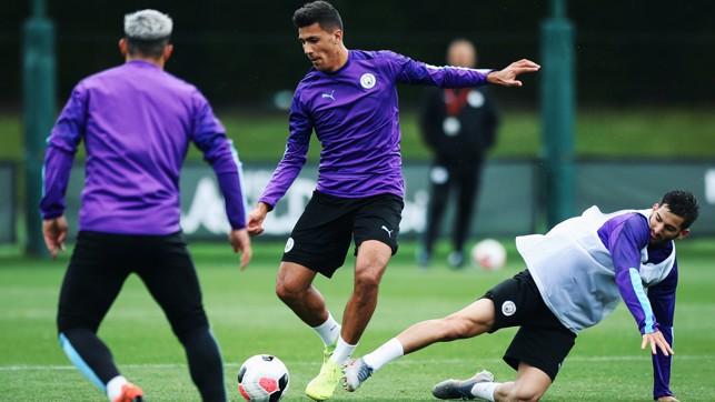 MIDFIELD ANCHOR : Rodrigo fends off a challenge