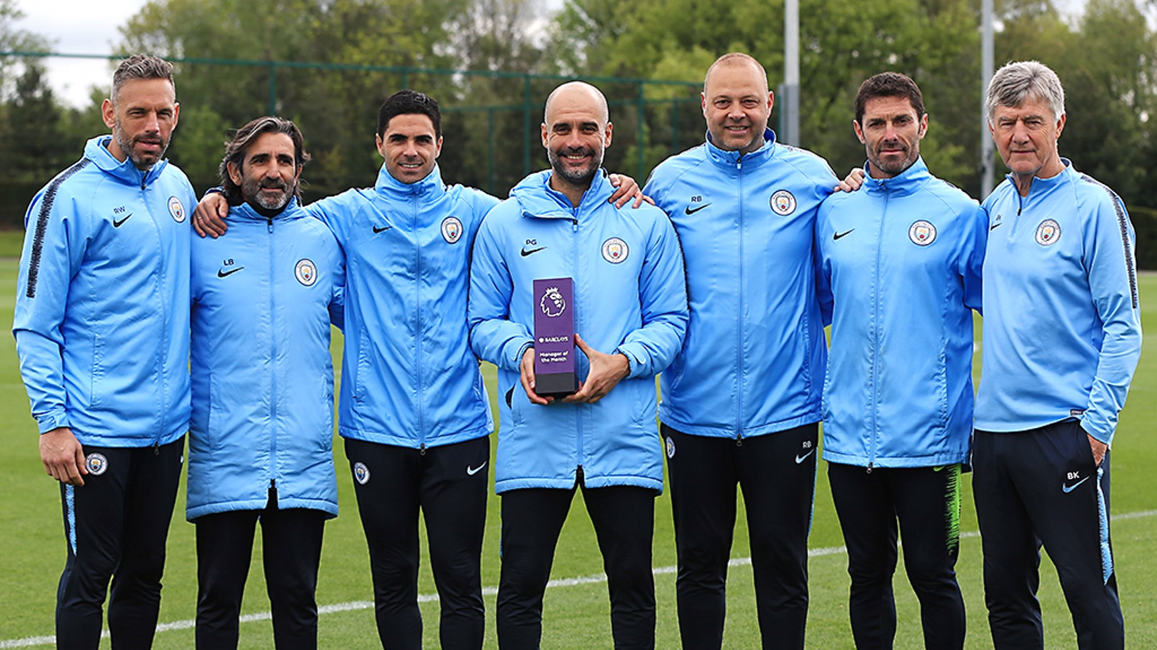 WINNER: Pep Guardiola celebrates his Manager of the Month award with his backroom staff.