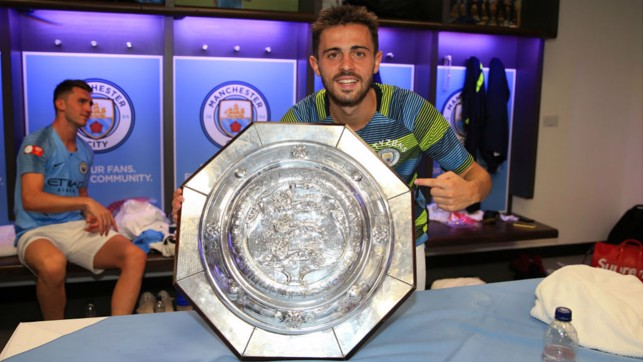 SMILES OF SUCCESS : Bernardo and City celebrate another piece of silverware after our Community Shield win over Chelsea in August 2018