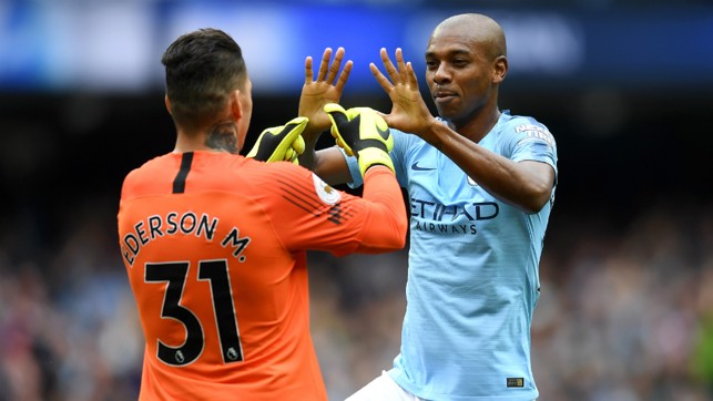 HE'S A KEEPER : Fernandinho congratulates Ederson on his outrageous assist - City's first created by a goalkeeper in the Premier League!
