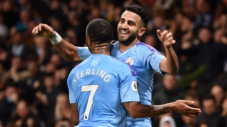 TOP TWO: Raheem Sterling is the first to celebrate with Riyad Mahrez