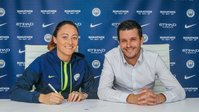 SIGN LANGUAGE : Megan with Head of Women's Football Gavin Makel