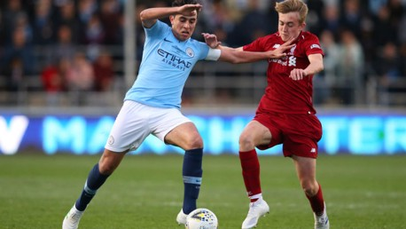 ACTION STATIONS: City skipper Eric Garcia fends off Jake Cain of Liverpool