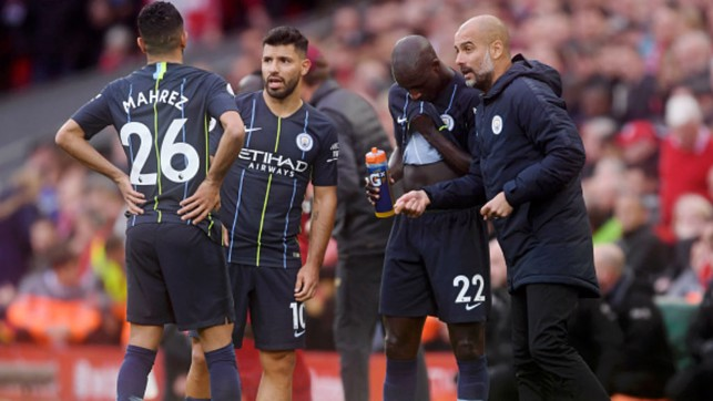 PLAYER INSTRUCTIONS : Pep coaches the players midway through the 0-0 draw against Liverpool