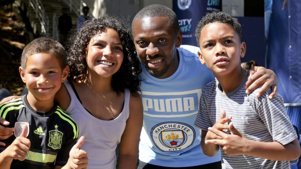 ALL SMILES : Shaun Wright-Phillips with some happy youngsters during our recent Trophy Tour to Brazil