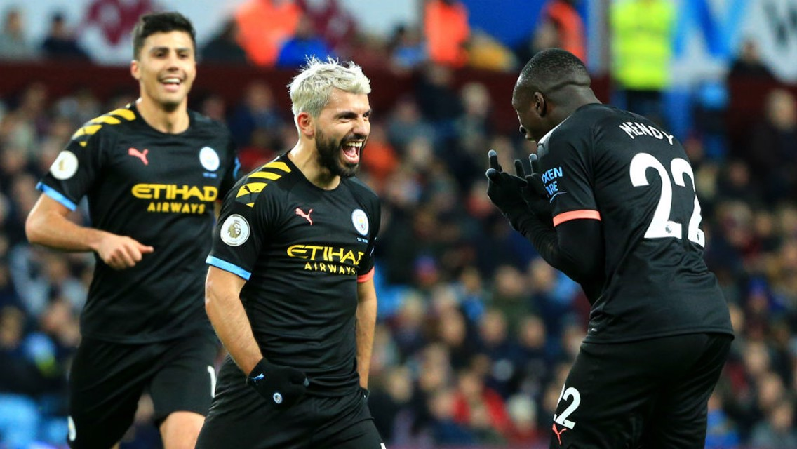 KUNDERFUL!! Sergio celebrates with Benjamin Mendy after his stunning first half strike