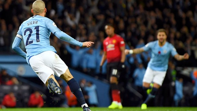 SUNDAY BEST : David Silva swivels away in delight after his opener