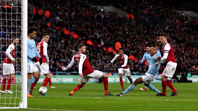 POACHER'S FINISH : Kompany scores City's second in the 2017/18 League Cup Final triumph over Arsenal