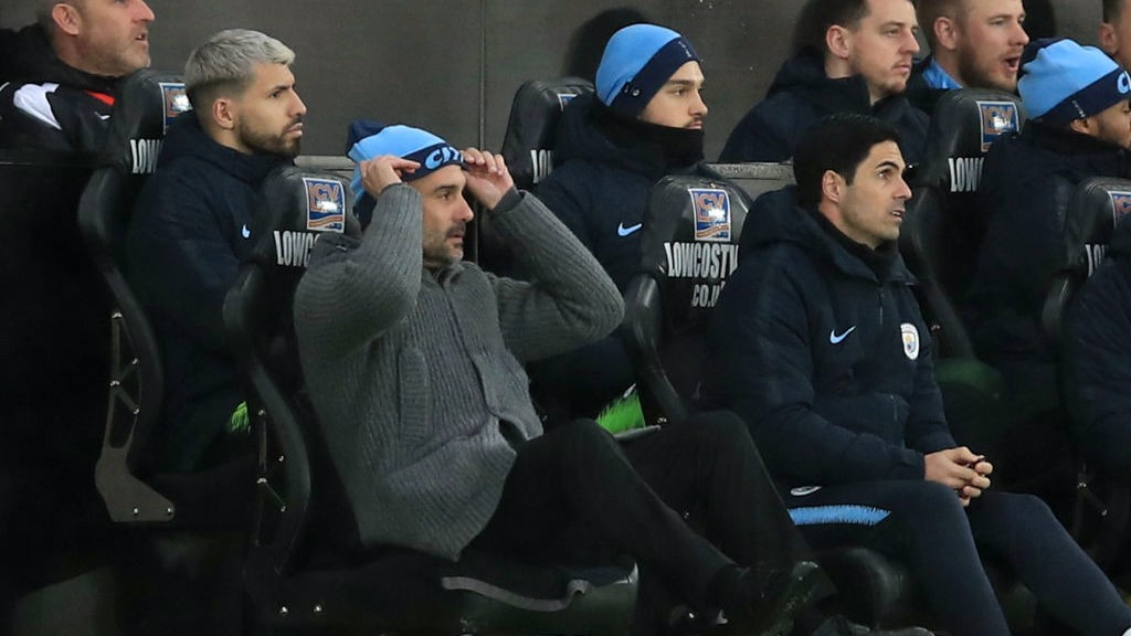 CHALLENGE: Pep Guardiola and the Blues bench look on in dismay after Swansea's second goal