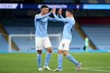 Ferran Torres congratulates goal-scorer Phil Foden