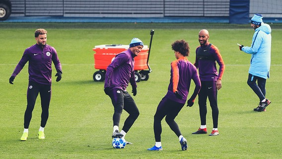 FOUR'S KOMPANY: The skipper has some fun with Leroy Sane