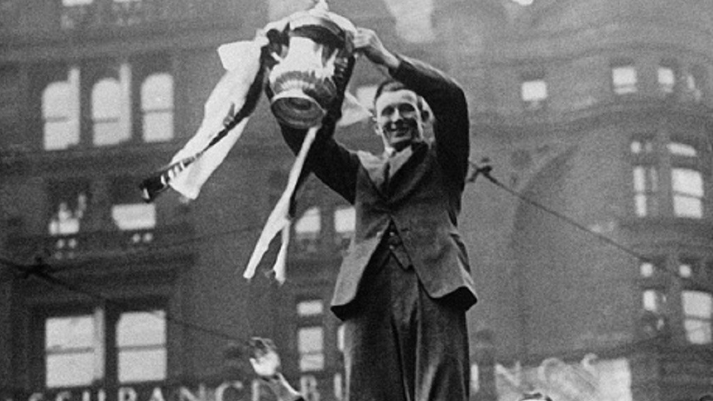 SAM COWAN : With the FA Cup on  top of a bus in the Manchester city centre