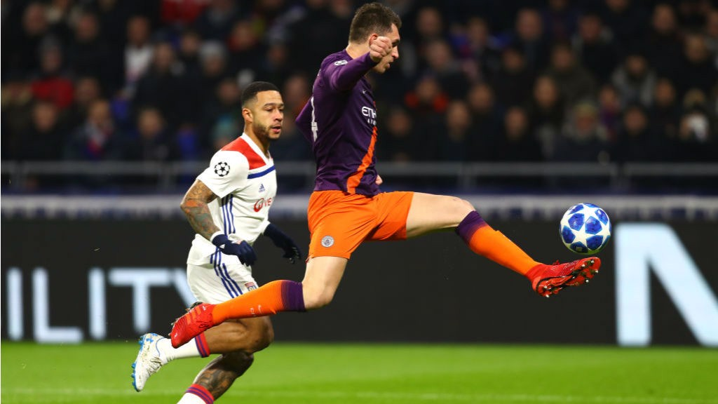 AT FULL STRETCH : Aymeric Laporte clears from Memphis Depay