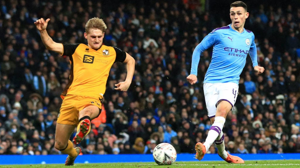 FOUR TOPS : Phil Foden is on target to register City's fourth goal of the evening