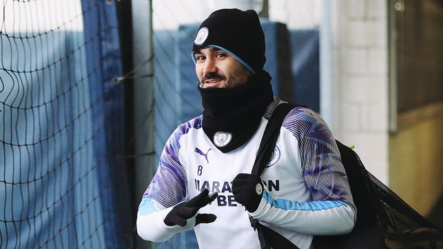 IT'S A WRAP : Ilkay Gundogan is dressed to keep out the elements as he reports for duty