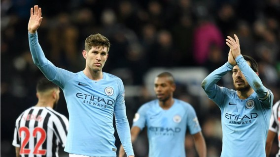 TOUGH NIGHT: A disappointed John Stones and David Silva salute the travelling City fans after the full time whistle
