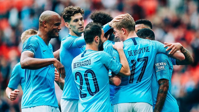 DE BRUYNE DELIGHT : The team congratulate the Belgian for his goal