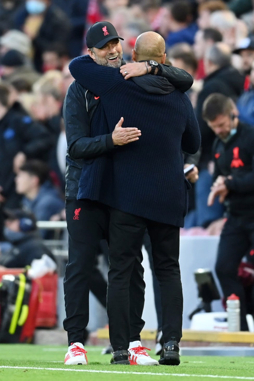 SPOILS SHARED : Guardiola and Klopp end with a hug - points shared.