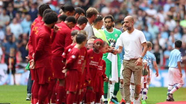 HANDSHAKES : City and Liverpool get the season's curtain raiser underway.