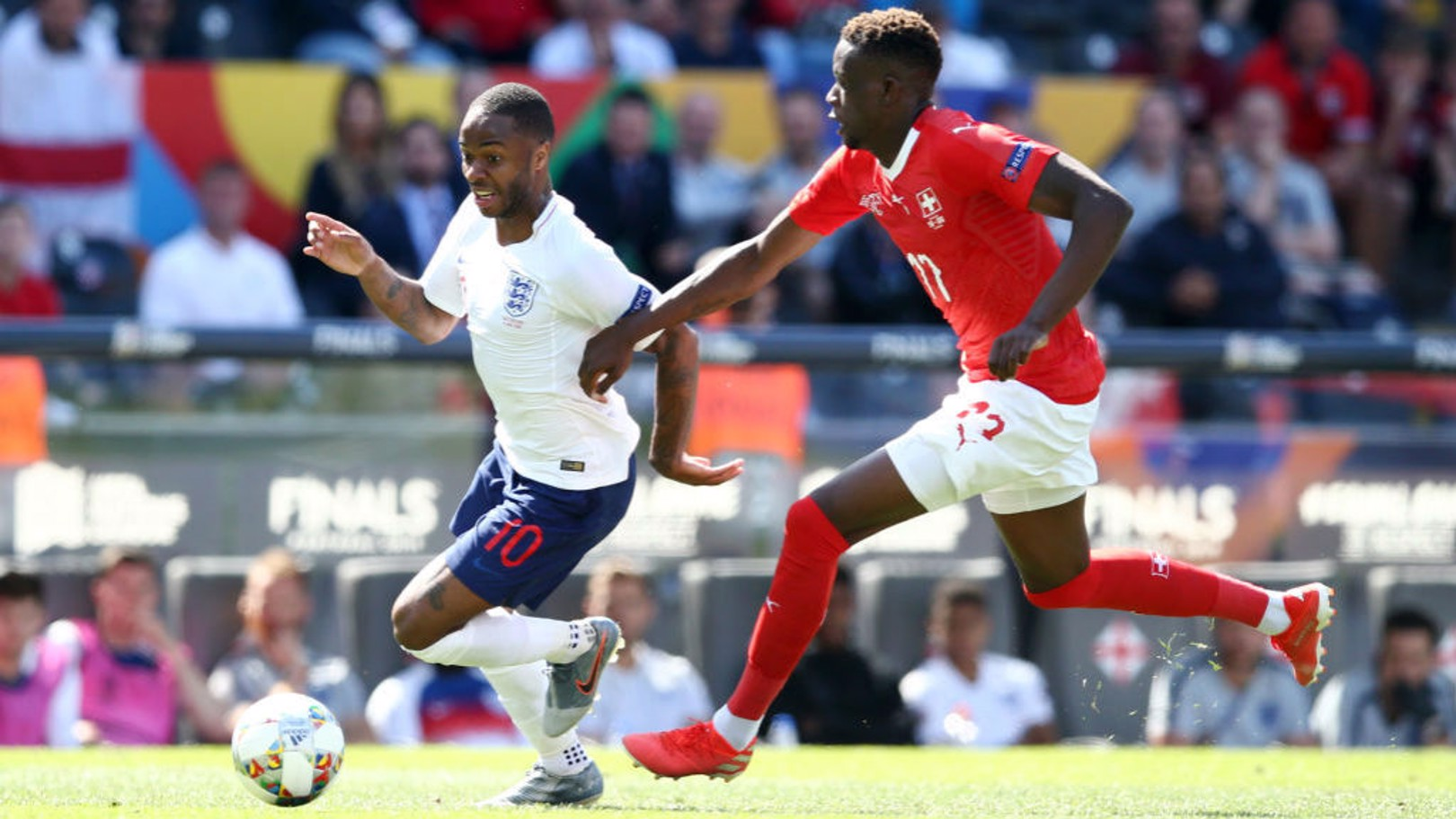 SUNDAY BEST: Raheem Sterling drives forward for England against Switzerland
