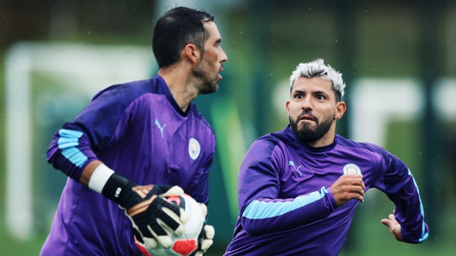 UNDER PRESSURE : Sergio Aguero gets up close and personal with Claudio Bravo