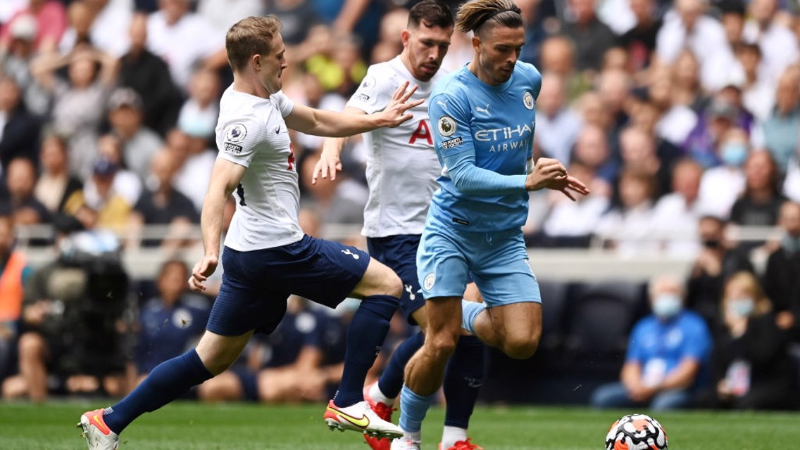 ON THE FRONT FOOT: Grealish carries City forward early on.