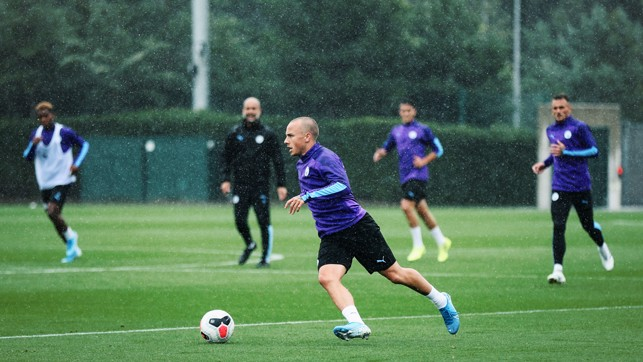 FLYING FULL-BACK : Angelino drives forward with possession
