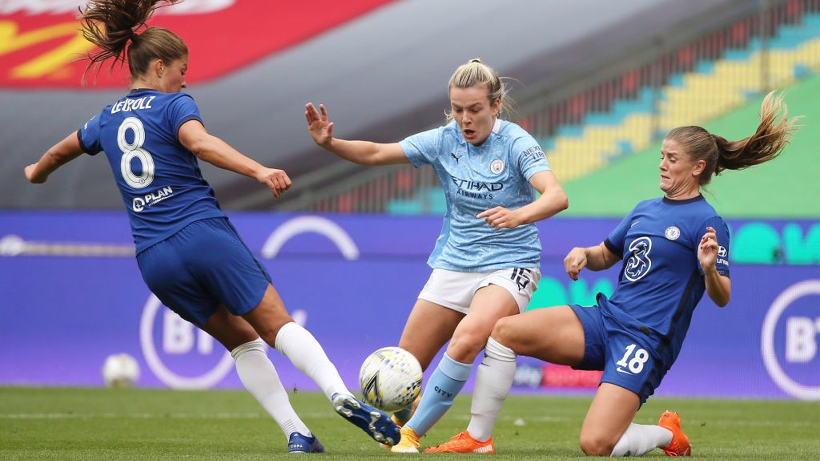 BATTLE: Hemp attempts to weave her way beyond two Chelsea players early on.