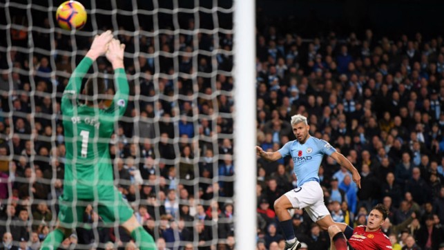 JUST TWO GOOD : Sergio Aguero slams home City's second goal with a thunderous strike