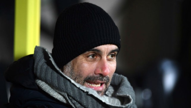 KEEPING WARM : Pep wraps up on a chilly night at the Pirelli Stadium