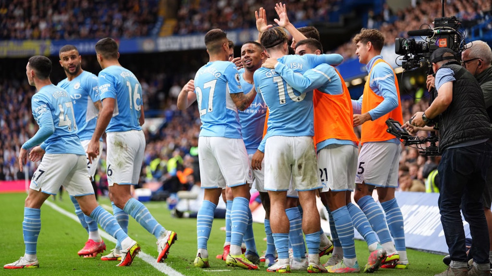 SQUAD GOALS: The starting players and the subs all come together to celebrate the goal.
