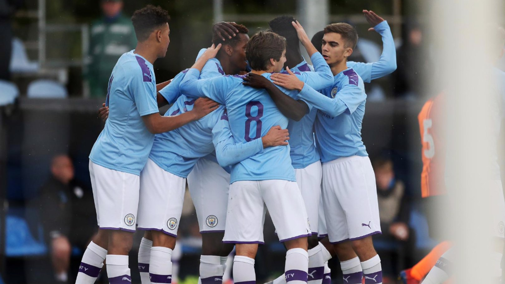 ALL TOGETHER NOW: The team gather to celebrate, as City double the advantage