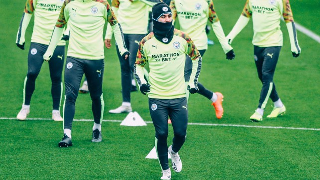 SNOOD OPERATOR : Ilkay Gundogan was well wrapped up to keep out the elements