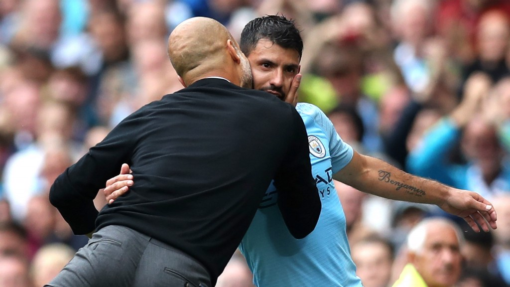 MAN OF THE MATCH : Pep Guardiola shows his appreciation for his hat-trick hero