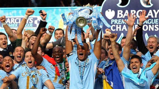 ECSTASY : The Belgian lifts the Premier League trophy aloft in 2012