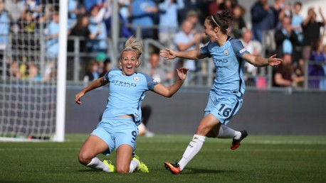 PURE EMOTION: Duggan and Jane Ross get the celebrations started after the former gave City a 2-0 lead.