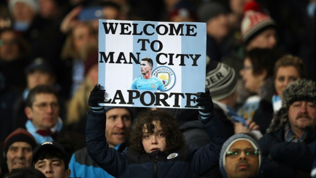 FAN-TASTIC : The Blues faithful display a welcome sign to our new arrival before Aymeric's debut