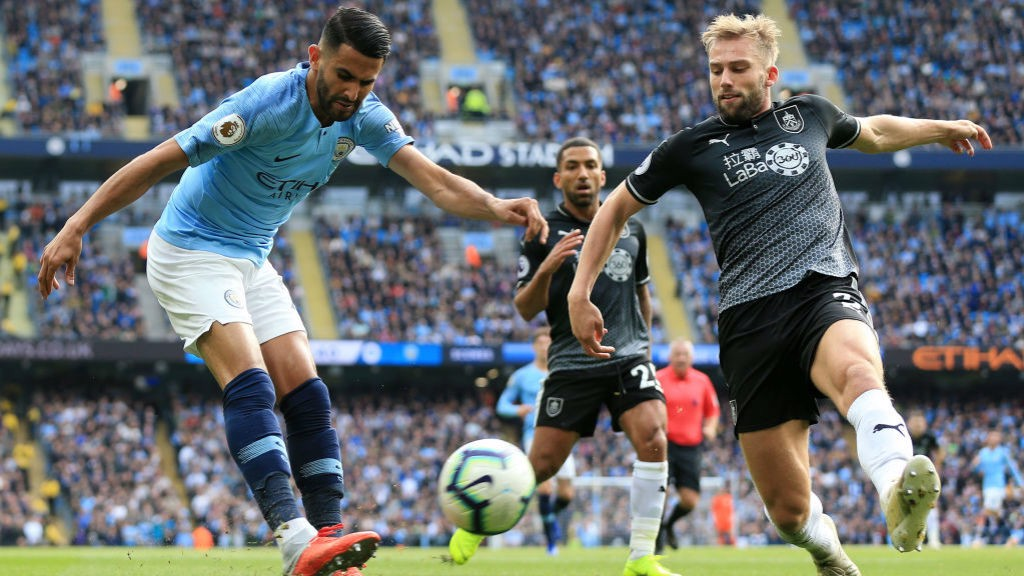 INGING IN : Riyad Mahrez whips over a cross from the right flank