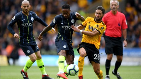 BY THE RIGHT: Raheem Sterling fizzes in a shot on the Wolves goal but is denied by Patricio's wonder save