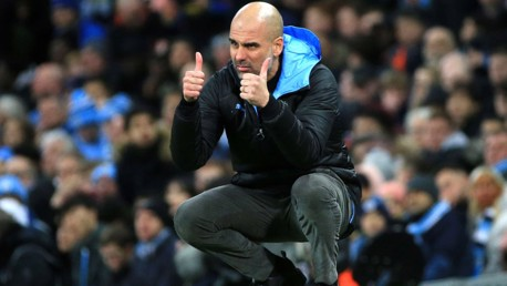 THUMBS UP: Guardiola signals his approval from the touchline.
