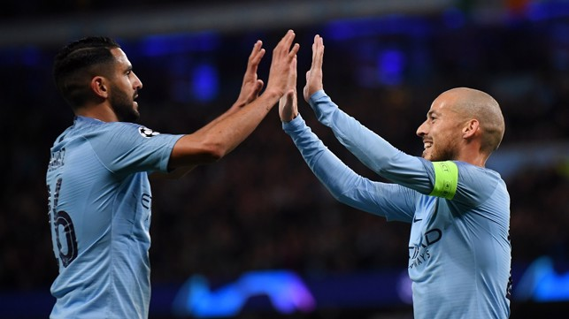HIGH FIVE : Riyad Mahrez congratulates David Silva on his opener