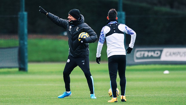 INSTRUCTING : Pep gets his point across to David Silva.