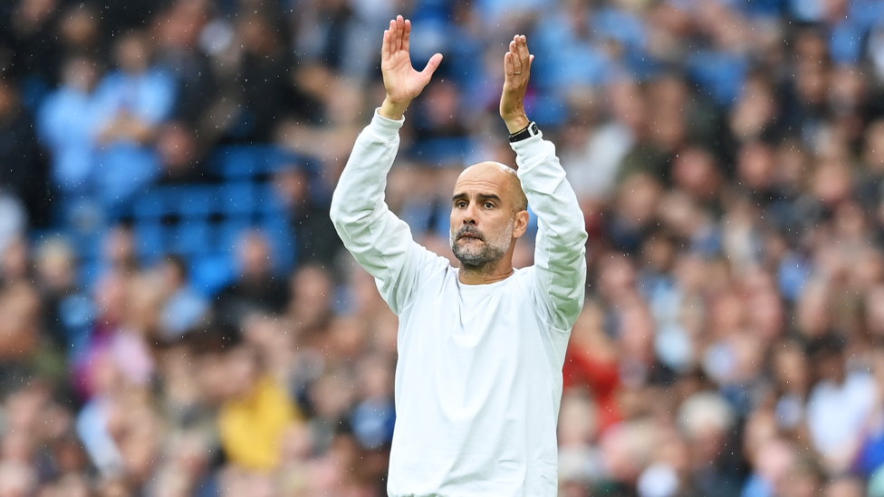 SEAL OF APPROVAL : Pep Guardiola applauds his players' efforts