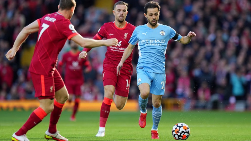 PACE TO BERN : Silva drives City up the pitch early on.