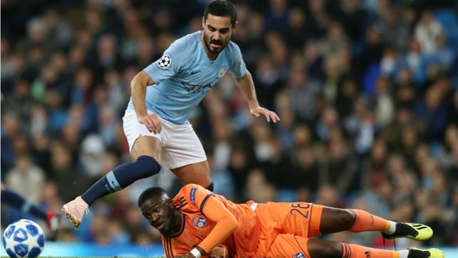 G FORCE : Ilkay Gundogan looks to power through the Lyon defence