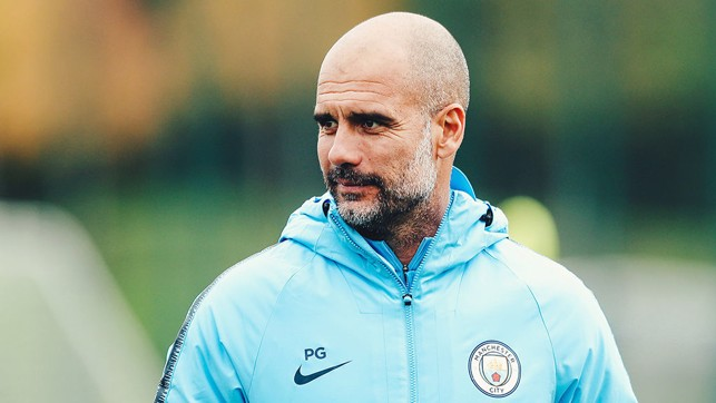 LEADING MAN : Pep Guardiola watches over the players as they go through their routines