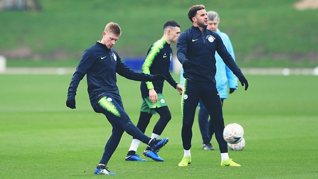 PASS MASTER : KDB limbers up with some passing practice