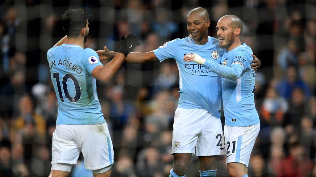 MIDFIELD MAESTRO : City celebrate Fernandinho's coolly-taken finish against West Brom -our 100th goal last term